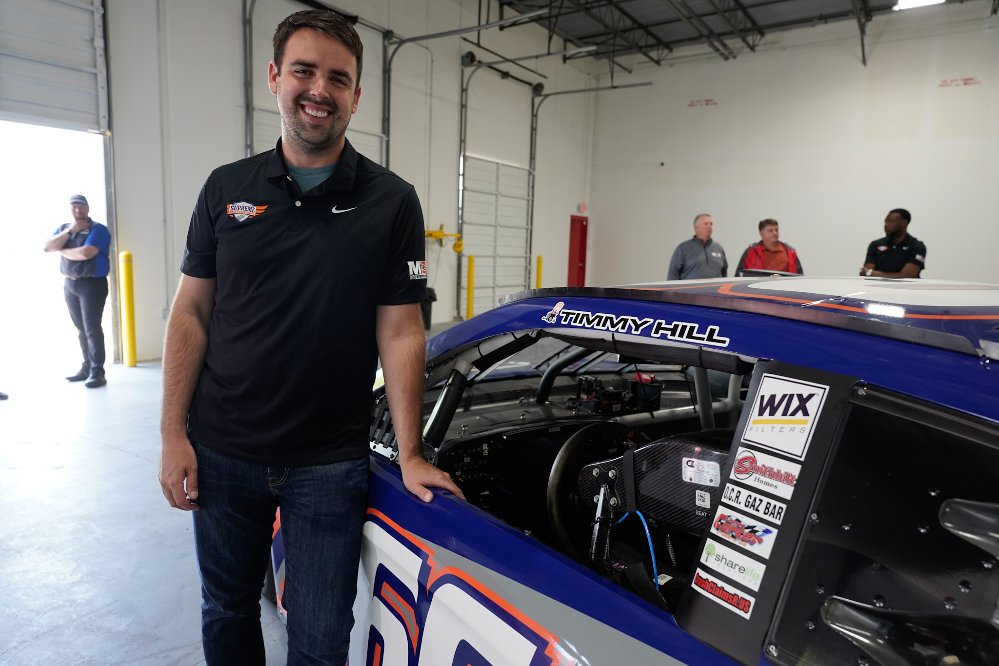 Timmy Hill-smiling beside his STG branded nascar